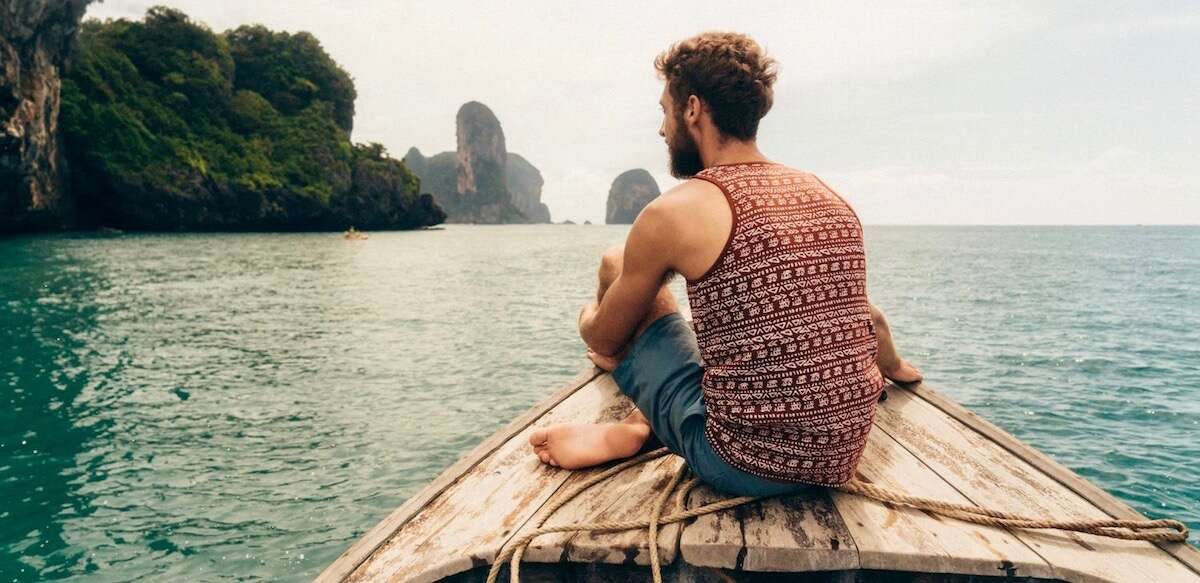 Travel Experiences Total Advantage Man Sitting on Boat