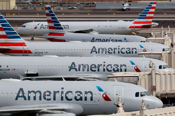 American Airlines sees 'slow but steady rise' in travel demand, restores some flights, lounges