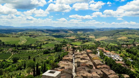 Aerial view of San Gimignano nestled in the green Tuscan hills