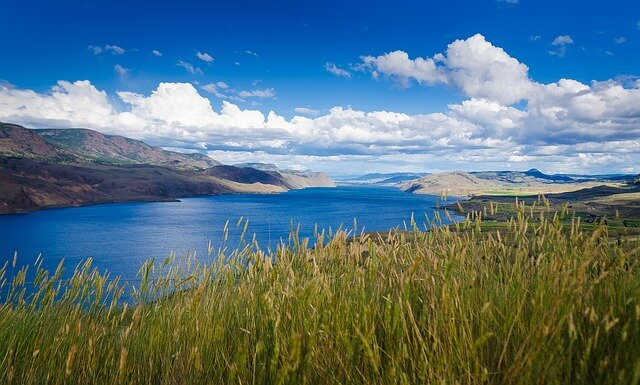 The sparkling lake of Kamloops provides a perfect mirror image of the enormous Alberta blue sky.